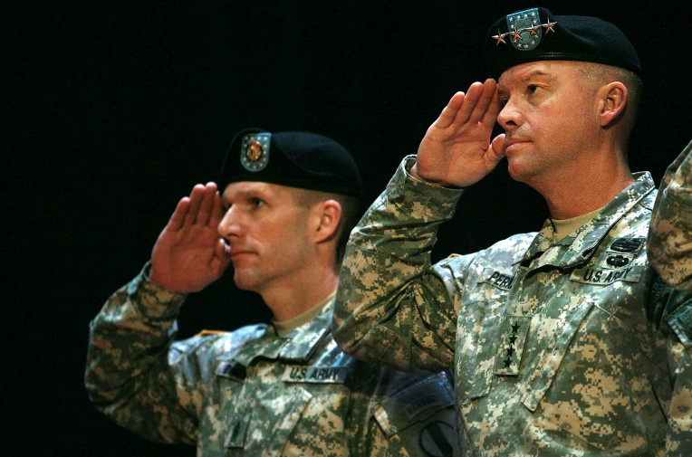 At Fort Eustis, incoming general David G. Perkins salutes during the change of command ceremony.