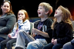 Walker Greentree, 7, and his cousin Hannah Greentree laugh as clowns perform during a small Ringling Bros. and Barnum & Bailey show for military families organized by Blue Star Families at Hampton Coliseum Thursday afternoon.
