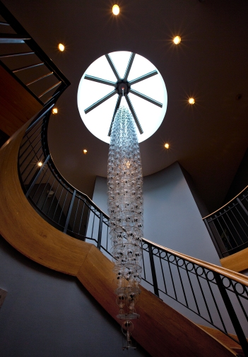 The Chrysler Chandelier, 2014 is constructed of glass radiometers, acrylic, stainless steel cable, and LED circuits. The 17 ft. height artwork was commissioned by the Chrysler Museum of Art.