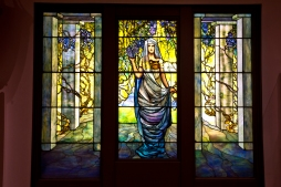 This display of Tiffany glass showcases the window display of Innovative glass by Louis C. Tiffany 1848-1933 inside the Chrysler Museum of Art.