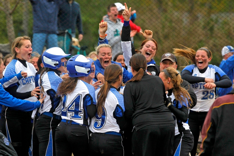 Christopher Newport University players swarm Taylor Dillow in celebration after she hit a two-run home run to defeat Salisbury for the Capital Athletic Conference tournament championship. (Photo by Jonathon Gruenke/Daily Press)