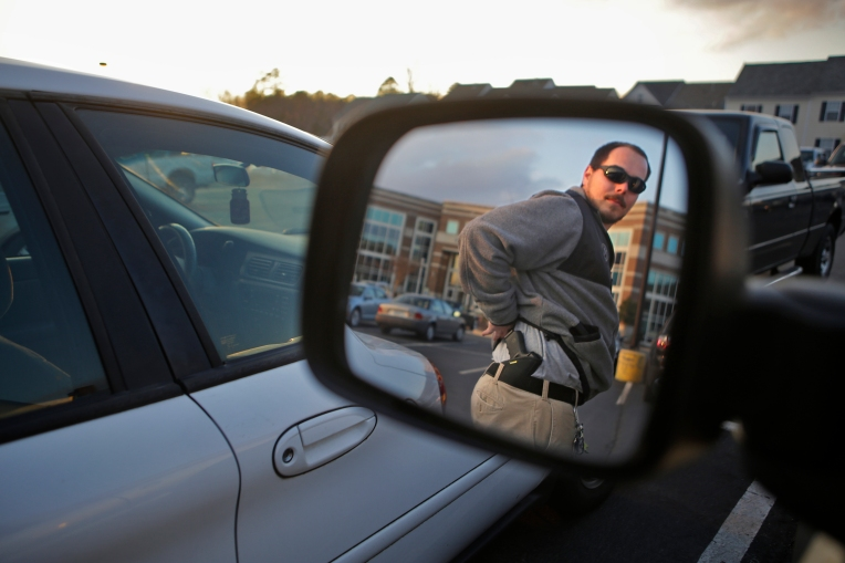 Concealed carry handgun permits on the Virginia Peninsula have risen significantly over the past five years.  Michael Christin of Toano purchased a concealed carry permit three years ago to protect himself while working as a delivery driver. Christin carries a Glock 19, 9mm compact. (Photo by Jonathon Gruenke/Daily Press)