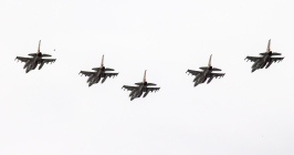 Israeli F-16 fighter jets perform during an air show, over the beach in the Mediterranean coastal city of Tel Aviv, AFP PHOTO / JACK GUEZJACK GUEZ/AFP/Getty Images