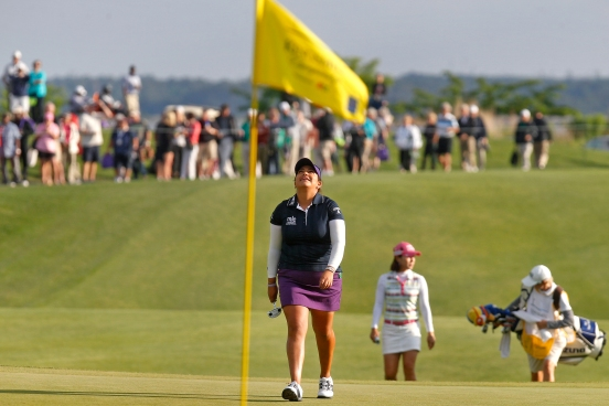 Lizette Salas, center, looks up into the sky as she approaches the 18th green during the final round of the LPGA Kingsmill Championship on Sunday in Williamsburg.