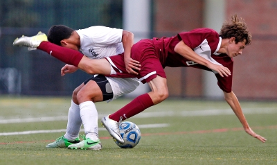 Lafayette's Andrew Vaccaro, left, and Poquoson's Collin Chance, right, battle for control of the ball during Tuesday's Conference 25 soccer semifinals at Wanner Stadium. (Photo by Jonathon Gruenke)