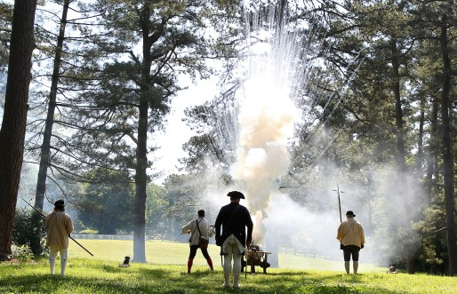 Jeffery Golding, Rick Davis, Justin Chapman and Walt Przybysc fire coehorn mortars honoring those that gave their lives during the American Revolution to celebrate Memorial Day Monday in Colonial Williamsburg. (Photo By Rob Ostermaier)