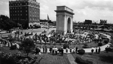Flags of the 50 states surround the perimeter of the Victory Arch during ceremonies on Memorial Day 1968. (Daily Press archive)