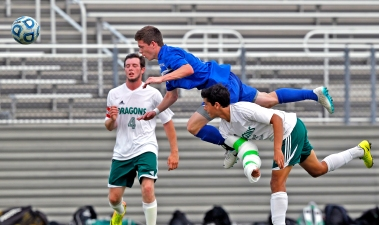 York's Max Poelker, center, jumps over Park View's miguel Pacheco, right, while attempting to head the ball during Tuesday's Conference 25 soccer semifinals at Wanner Stadium. To the left is Park View's Johnathan Upton. (Photo by Jonathon Gruenke)