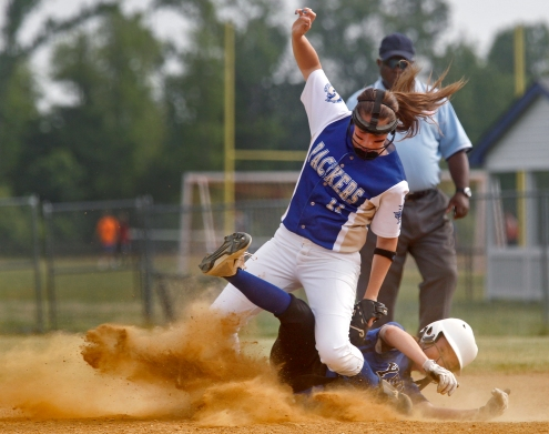 Smithfield's Ashley Newman, top, tags out York's Kayla Dianna while attempting to steal second base during Wednesday's game at Smithfield.