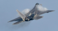 An F-22 starts a climb as vapor forms on the fighter's wings during a flight demonstration of the jet fighters capabilities at Langley Air Force Base Wednesday.