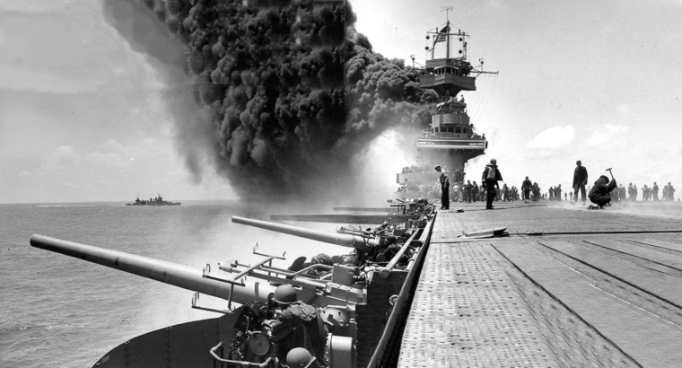 This view shows the giant plume of smoke coming from the USS Yorktown after it was attacked by Japanese planes during he Battle of Midway. The USS Astoria is shown in the left background. (Courtesy of the Naval History and Heritage Command / May 20, 2014)