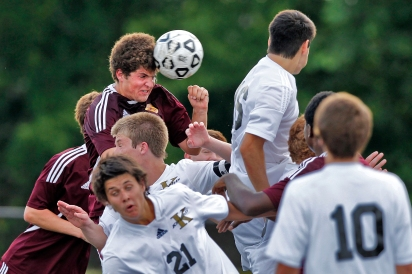 Warwick's Andrew Smith, center left, heads the ball through a crowd of Kellam players during Tuesday's first round of 5A South soccer tournament at Powhatan Sports Complex.