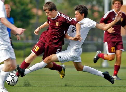 Warwick's Christian Murphy, left, battles for control of the ball with Kellam's Bryce Reed, right, during Tuesday's first round of 5A South soccer tournament at Powhatan Sports Complex.
