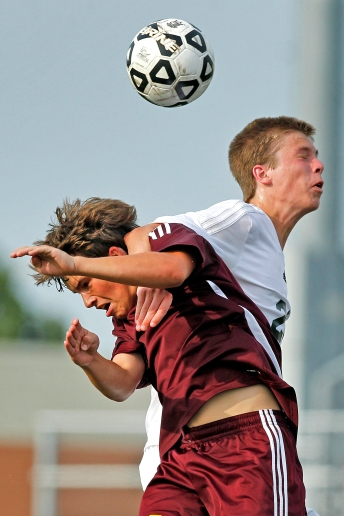 Warwick's Connor Murphy, left, and Kellam's Chris Dodd attempt to head the ball during Tuesday's first round of 5A South soccer tournament at Powhatan Sports Complex.