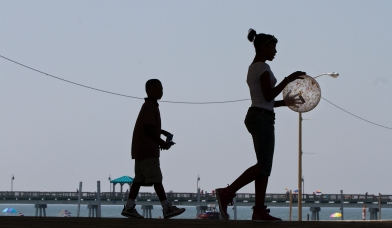 Kids play with a ball near the boardwalk at Buckroe Beach on Tuesday morning. (Photo by Kaitlin McKeown)
