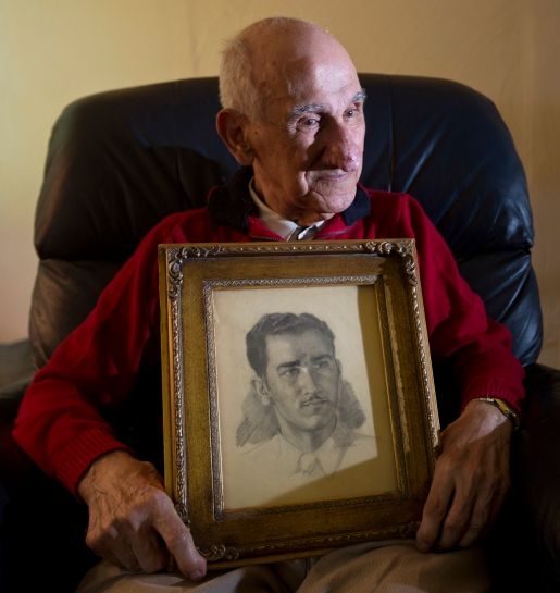 Army veteran Jacob Fricano, who landed on Omaha Beach two days after the June 6, 1944 initial assault, holds a drawing of himself that was done by a German prisoner of war. (Photo by Kailtin McKeown)