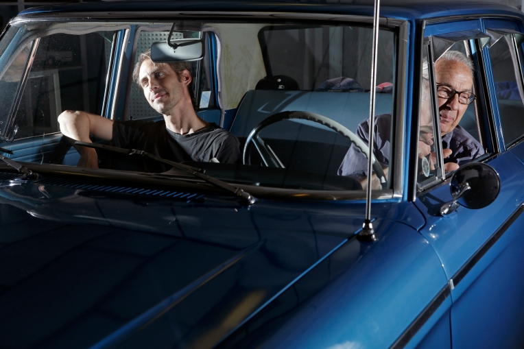 Chris Hylton followed in his father's footsteps, learning the trade of automotive repair as he helped his father, Dalton Hylton in the shop in Newport News, Va.  Dalton Hylton, right, sits in his 1964 Studebaker with his son, Chris Hylton, left, inside their automotive repair shop in Newport News.