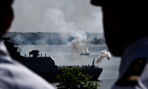 The French frigate La Fayette fires a 21-gun salute from the York River during ceremonies to honor the French sailors and soldiers and their American Allies, that participated in the siege of Yorktown in 1781, that resulted in the surrender of British forces at Yorktown.