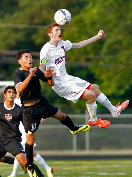 Grafton's Dom DiGangi, right, heads the ball away from Nansemond River's Brayan Morales, left, during Wednesday's 4A South region soccer semifinals at Bailey Field.