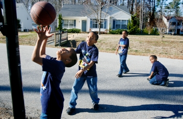 """The Jones quadruplets from left, Kameron, Karlyle, Karon, and Kahlil, play a few games of """"Horse"""" on the basketball hoop outside their home in Smithfield. The boys, now 10, were the first set of quadruplets born at Riverside Regional Medical Center and are two sets of identical twins. (Daily Press file Photo)(February 15, 2006)"""