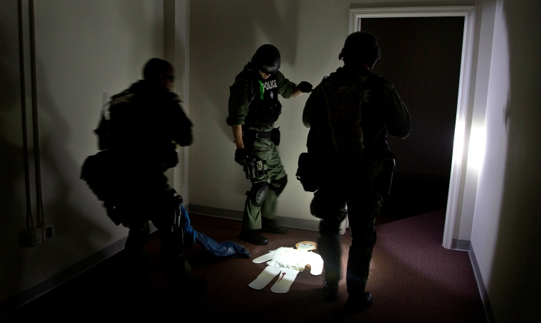 A cardboard cutout lays on the floor during a search for wounded victims by tactical team members inside the closed Williamsburg outlet mall.