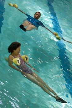 Gerry Belden, top, and Hsiuhsia Adams participate in instructor Pauline Higgins' aqua-aerobics class at the Riverside Wellness Center in Newport News on Thursday. Mrs. Higgins, 89, teaches three 55-minute classes back to back on Tuesdays and Thursdays.