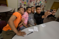 Quads Kahlil Jones, Karlyle Jones, Karon Jones and Kameron Jones break from an interview to grab a selfie inside Warwick High School. The four will graduate on Saturday from Warwick High School and all are members of the National Guard. (Photo by Adrin Snider)