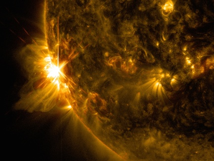 A solar flare bursts off the left limb of the sun in this image captured by NASA's Solar Dynamics Observatory on June 10, 2014, at 7:41 a.m. EDT. This is classified as an X2.2 flare, shown in a blend of two wavelengths of light: 171 and 131 angstroms, colorized in gold and red, respectively. Image Credit: NASA/SDO/Goddard/Wiessinger