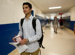 Khalil Duncan makes his way down the hall at York High School after a completed one of his classes Thursday. Duncan is on a limited schedule and only needs to complete two classes to fulfil his graduation requirements. A concussion suffered during a soccer game earlier in the year led to months of therapy and rest.