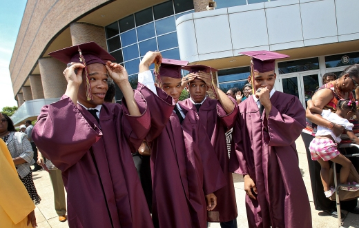 The Jones quintuplets from left to right; Kahil, Karlyle, Karon and Kameron get ready to pose for family photos Saturday after graduating from Warwick High.