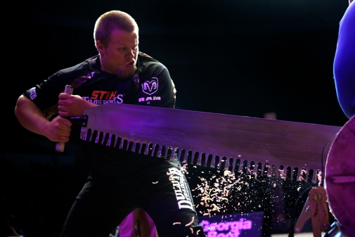 Joshua Wilson saws through a piece of wood during the single buck event of Friday's Stihl Timbersports collegiate championship qualifying rounds at Norfolk Scope Arena.