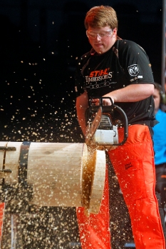 Griffith Wilson cuts through a piece of wood with a saw during the stock saw event of Friday's Stihl Timbersports collegiate championship qualifying rounds at Norfolk Scope Arena.