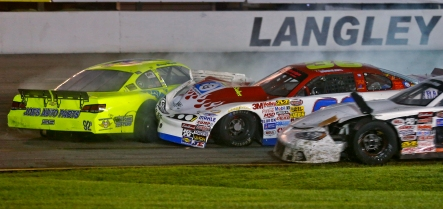 Casey Wyatt, left, Chris Johnson, center, and Brandon Brown, right, become tangled together during Saturday's Hampton Heat 200 at Langley Speedway. (Photo by Jonathon Gruenke)