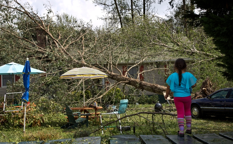 Near Cherrystone campground on Wilkins Dr. the home of Mike and Tammy Brady has two trees on the roof as their granddaughter looks on at 11:30AM.