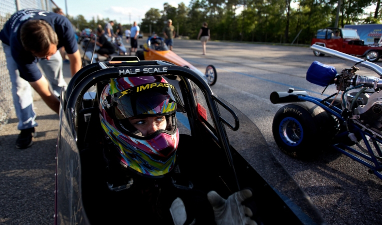 Rachael Whitney gets gets her gear on and prepares to race from in the staging lanes. To win a race the driver has to either hit their dialed in time down the track or force the other driver to bust their time by a larger margin.