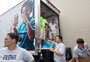 Food Lion employees help load bags of groceries into vehicles during a food donation event put on by New England Patriots linebacker Jerod Mayo, Food Lion Feeds and the Foodbank of the Virginia Peninsula on Wednesday in Hampton.