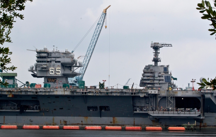 Thursday's ceremony was held at Victory Landing Park in downtown Newport News. In the shadow of the USS Enterprise, the world's first nuclear carrier and first of the Nimtz-class, the two brothers shook hands as Ravelo took over. (Photo by Joe Fudge)