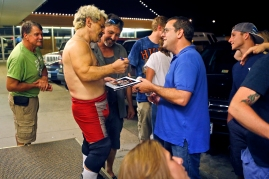 Danny Campbell, center, greets and signs autographs for fans after a wrestling performance at Cozzy's Comedy Club Wednesday evening. (Photo by Jonathon Gruenke)