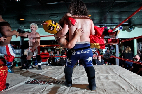 Wrestlers perform at Cozzy's Comedy Club Wednesday evening. (Photo by Jonathon Gruenke)
