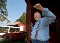 Tommy Thompson talks about Willow Oak Farm along Back River in Hampton, which has been in his family for generations. His farm boards horses and produces pecans, eggs, beef and hay. (Photo by Kaitlin McKeown)