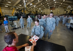 NASCAR driver Kevin Harvick signs autographs for troops during a visit to Fort Eustis on Wednesday.