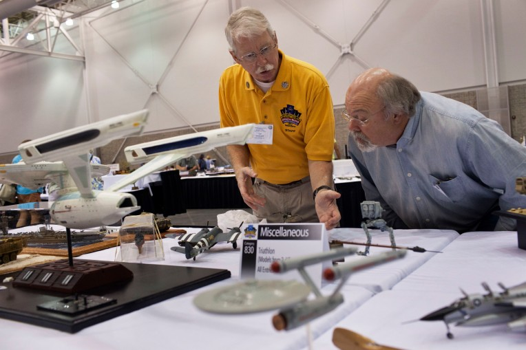 Judge Gip Winecoff, left, and David Morris at the 2014 National Convention of the International Plastic Modelers Society, at the Hampton Convention Center, on August 7, 2014.  Over 800 plastic modelers from throughout the world displayed over 2,500 models of aircraft, ships, tanks, cars, missiles/spacecraft during the event.