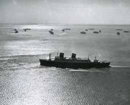 SS America -- Taken after the SS America's into a passenger liner was completed at Newport News Shipbuilding, this aerial shot shows the vessel leaving Hampton Roads.