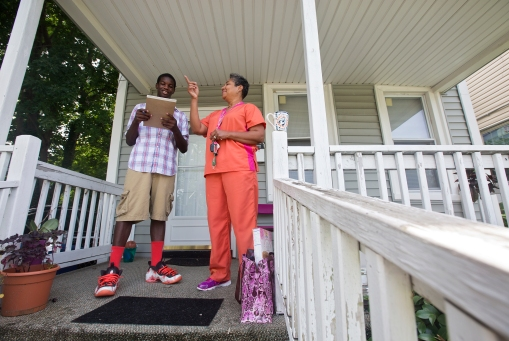Malik Spencer, 15, talks with Kim Williams about her neighborhood as a part of the Newport News Department of Human Services TOP Program on Monday in Southeast Newport News. (Photo by Kaitlin McKeown)
