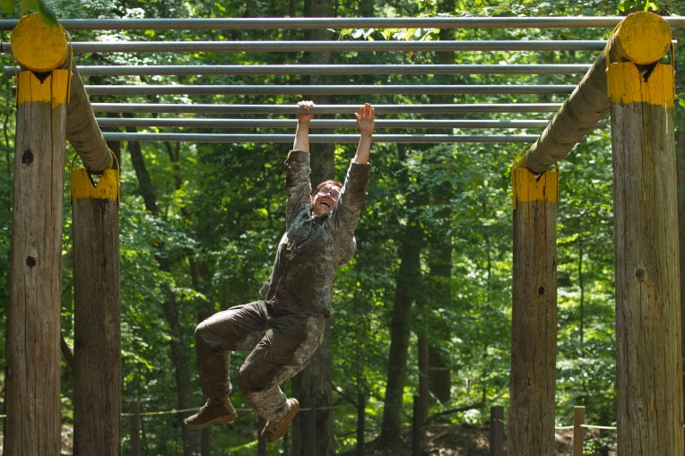 Sergeant Vivian Rebstock, from Fort Sill, Oklahoma during  the obstacle course section of the competition for  U.S. Army Training and Doctrine Command  (TRADOC) Noncommissioned Officer and Soldier of the Year at Fort Eustis in Newport News on August 6, 2014. he Soldiers are representing the major commands (Direct Reporting Units and Center of Excellences) commanded by TRADOC. (Photo by Stephen Reiss)