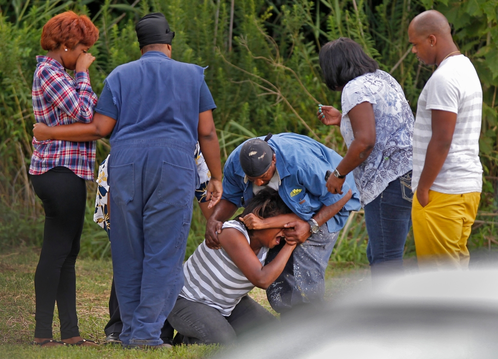 Family members grieve at the scene of where two Newport News' men drowned while swimming in Deep Creek Tuesday afternoon.