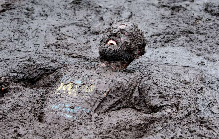 A competitor competes in the Mud Madness race, at Foymore Lodge in Portadown, County Armagh on September 14, 2014. Some 800 Competitors ran, crawled and belly-flop their way across four and half miles of bogs and ponds, under cargo nets and through water sprays and muddy trenches in aid of Charity.    AFP PHOTO / Paul FaithPAUL FAITH/AFP/Getty