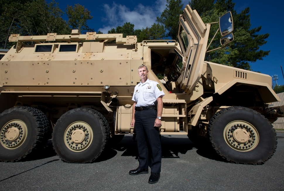 "York-Poquoson Sheriff J.D. ""Danny"" Diggs stands in front of a Mine-Resistant Ambush Protected (MRAP) vehicle that the York-Poquoson Sheriff's Office acquired in May. (Photo by Kaitlin McKeown)"