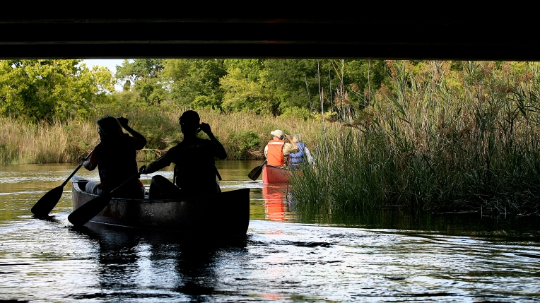 The Hampton city council takes a canoe trip up New Market Creek Wednesday to Air Power Park. They wanted to get an idea of the recreational potential of the water way that runs through the heart of Hampton. (Photo by Rob Ostermaier)