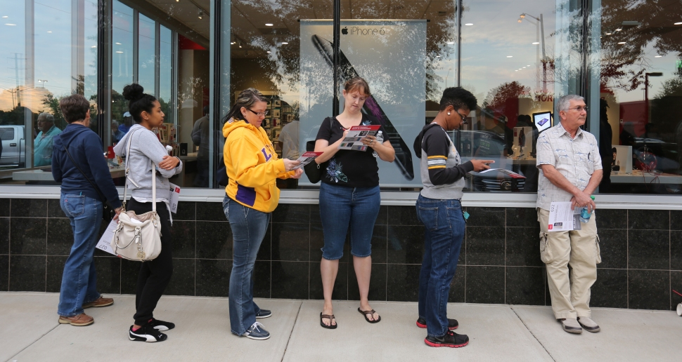 Customers wait patiently outside the Verizon store in Newport News to get his new iPhone 6 early Friday. Customers began arriving in line as early as 1:30 am Friday. (Photo by Adrin Snider) For more photos click here. For video.